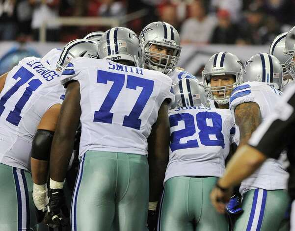 Dallas Cowboys quarterback Tony Romo (9) calls a play in the huddle during the first half of an NFL football game against the Atlanta Falcons Sunday, Nov. 4, 2012, in Atlanta. (AP Photo/David Tulis) Photo: David Tulis, Associated Press / FR170493 AP