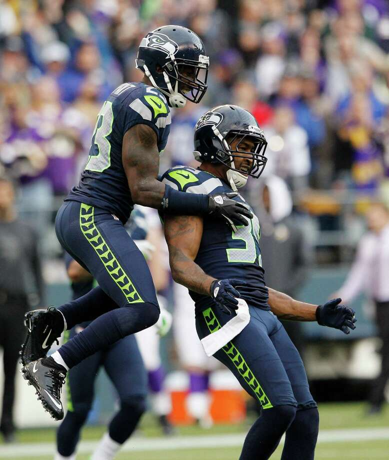 Seattle Seahawks' Marcus Trufant, left, and Brandon Browner celebrate Browner's interception against the Minnesota Vikings late in the second half of an NFL football game, Sunday, Nov. 4, 2012, in Seattle. The Seahawks won 30-20. Photo: AP