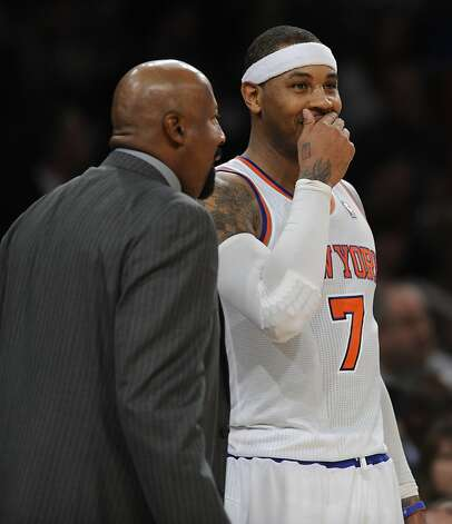 Carmelo Anthony, with coach Mike Woodson, led the Knicks with 27 points. Photo: Henny Ray Abrams, Associated Press