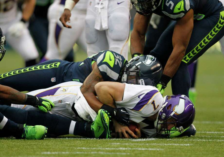 Minnesota Vikings' Christian Ponder (7) is sacked by Seattle Seahawks' Jeron Johnson (32) in the first half of an NFL football game, Sunday, Nov. 4, 2012, in Seattle. Photo: AP