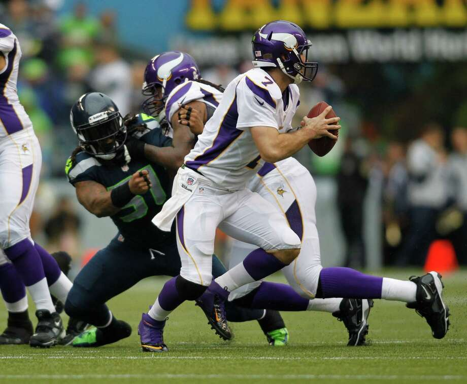 Minnesota Vikings' Christian Ponder (7) looks to pass against the Seattle Seahawks in the first half of an NFL football game, Sunday, Nov. 4, 2012, in Seattle. Photo: AP