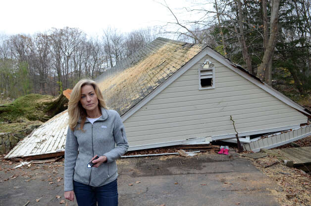 Michelle Morris stands in front of her collapsed garage located on Hunting Ridge Rd. in Stamford, on Thursday, Nov. 1, 2012. Photo: Amy Mortensen / Connecticut Post Freelance