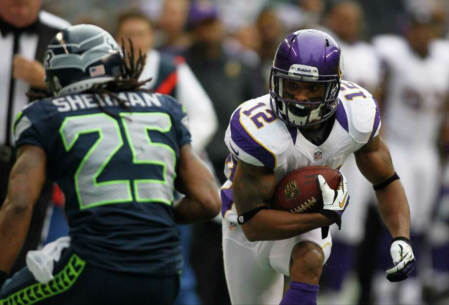 Minnesota Vikings' Percy Harvin, right, rushes against Seattle Seahawks' Richard Sherman during an NFL football game, Sunday, Nov. 4, 2012, in Seattle. Photo: AP