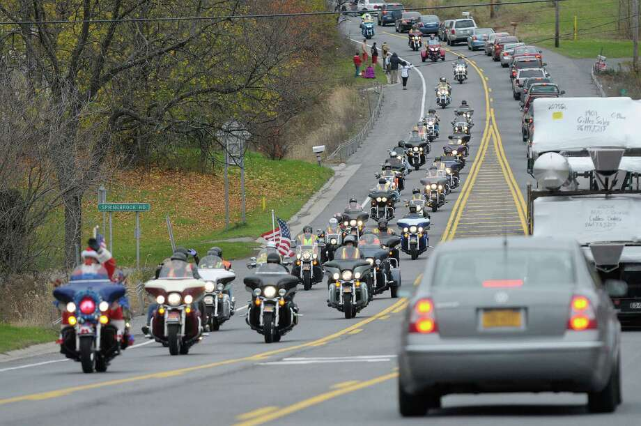 Motorcycle riders drive along Route 7 after leaving the Brunswick Harley Davidson during the 14th annual Toys for Tots Benefit Ride put on by The Brunswick Harley Owners Group on Sunday, Nov. 4, 2012 in Troy, NY.  The ride is held to raise money and toys for the Marine Corp League Toys for Tots Program.  The riders rode from the Brunswick Harley Davidson shop to Niskayuna.   (Paul Buckowski / Times Union) Photo: Paul Buckowski  / 00019836A