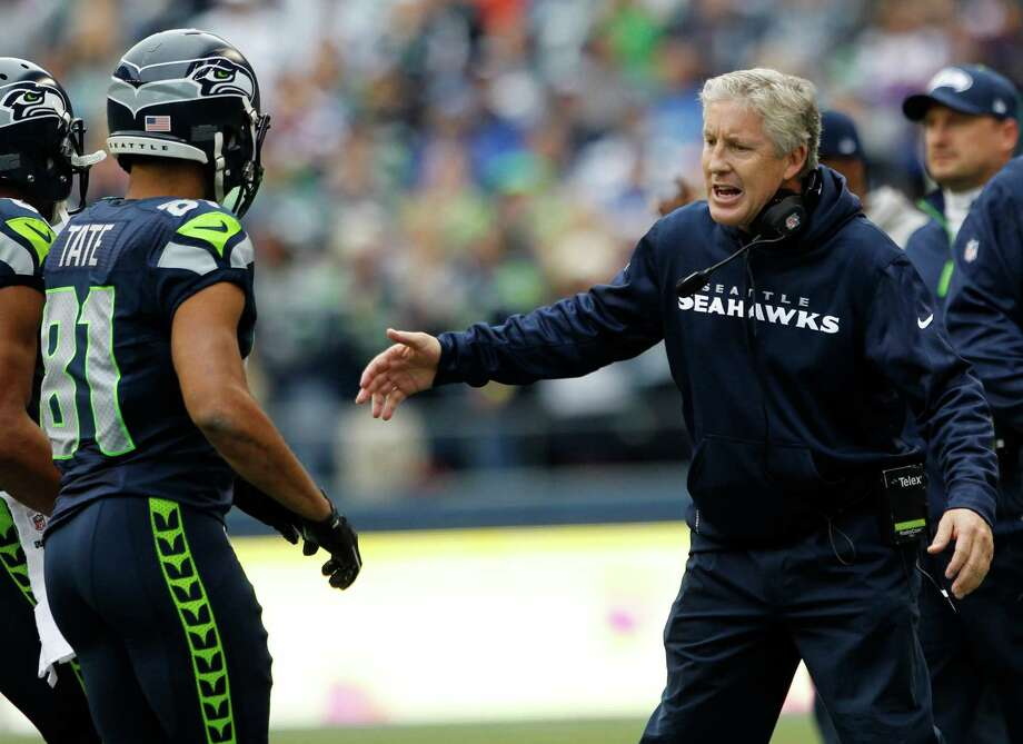 Seattle Seahawks head coach Pete Carroll greets Golden Tate after a play against the Minnesota Vikings in the first half of an NFL football game, Sunday, Nov. 4, 2012, in Seattle. Photo: AP