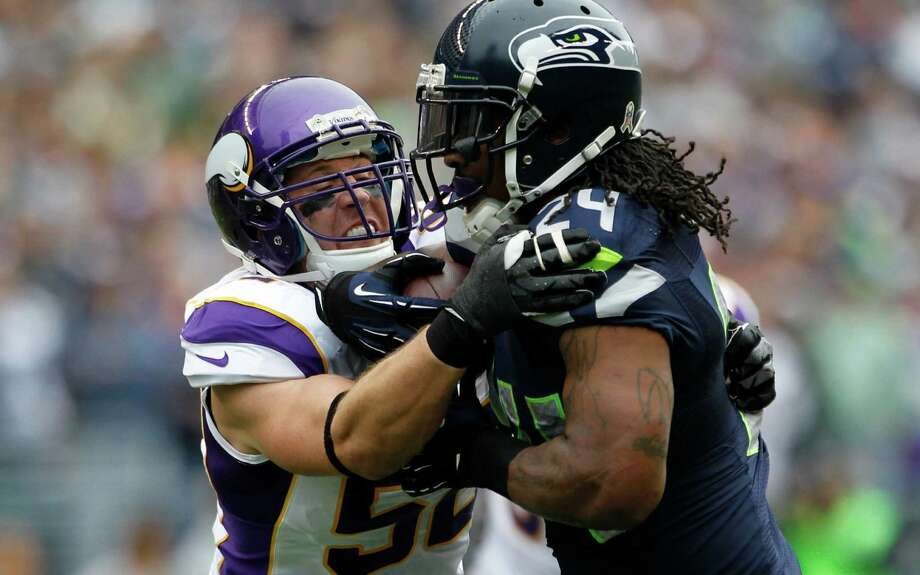 Seattle Seahawks' Marshawn Lynch, right, rushes against Minnesota Vikings' Chad Greenway (52) in the first half of an NFL football game, Sunday, Nov. 4, 2012, in Seattle. Photo: AP