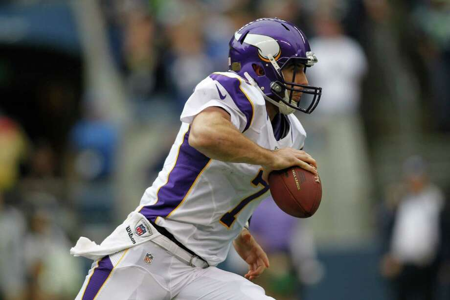 Minnesota Vikings quarterback Christian Ponder looks to pass against the Seattle Seahawks in the first half of an NFL football game, Sunday, Nov. 4, 2012, in Seattle. Photo: AP