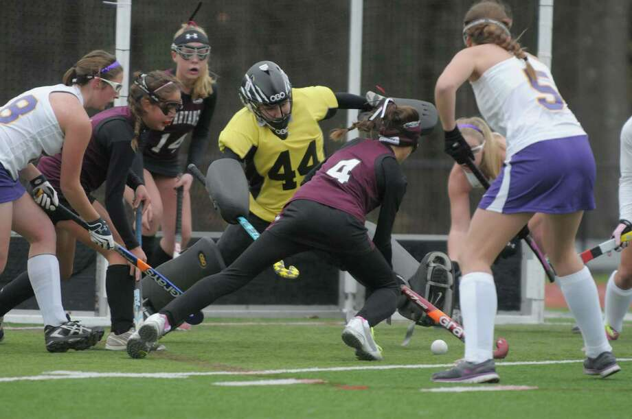 Elise Zwicklbauer, #4, of Burnt Hills Ballston Lake tries to get a shot past Alyssa Pertell, #44, goalkeeper for Johnstown during the Class B girl's field hockey finals on Sunday, Nov. 4, 2012 in Clifton Park, NY.  Burnt Hills Ballston Lake won by the score of three to one.   (Paul Buckowski / Times Union) Photo: Paul Buckowski  / 00019940A