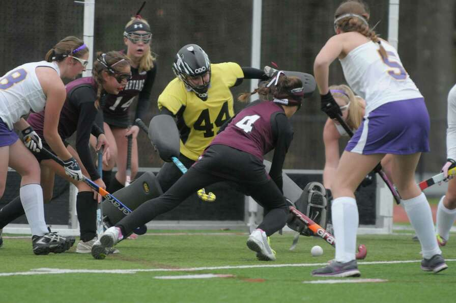 Elise Zwicklbauer, #4, of Burnt Hills Ballston Lake tries to get a shot past Alyssa Pertell, #44, go