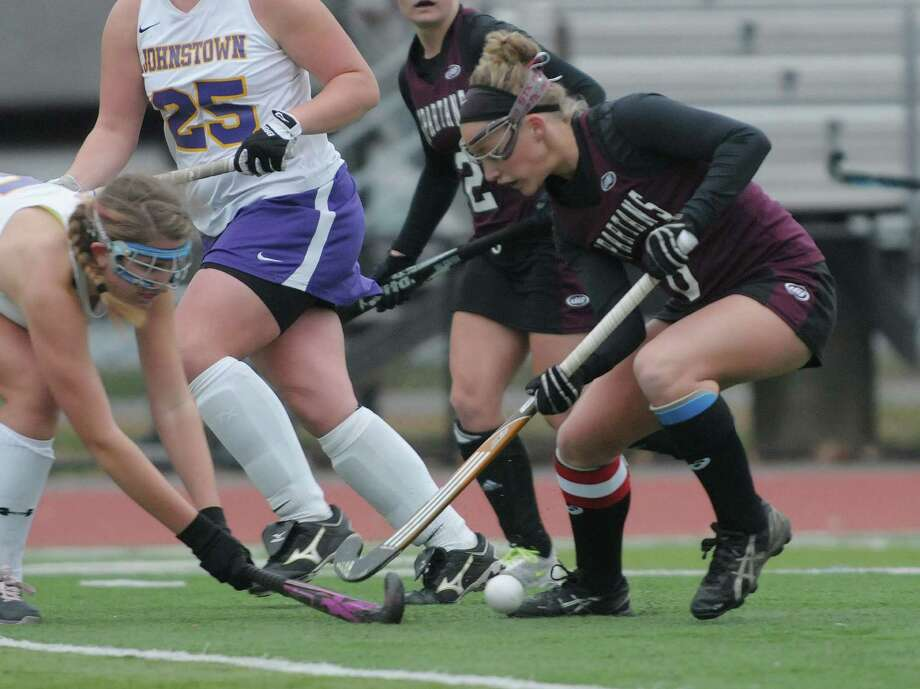 Meghan Largo, right, of Burnt Hills Ballston Lake brings the ball up the field past Johnstown defenders during the Class B girl's field hockey finals on Sunday, Nov. 4, 2012 in Clifton Park, NY.  Burnt Hills Ballston Lake won by the score of three to one.   (Paul Buckowski / Times Union) Photo: Paul Buckowski