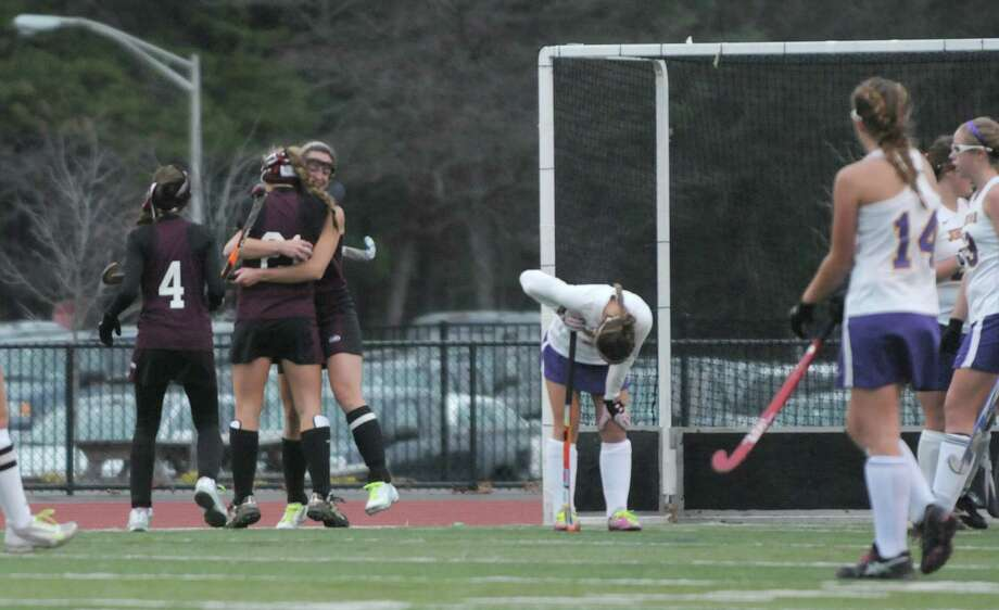 Burnt Hills Ballston Lake players, from left to right, Elise Zwicklbauer, Lexie Ball and Amy LeBel celebrate a goal against Johnstown during the Class B girl's field hockey finals on Sunday, Nov. 4, 2012 in Clifton Park, NY.  Burnt Hills Ballston Lake won by the score of three to one.   (Paul Buckowski / Times Union) Photo: Paul Buckowski
