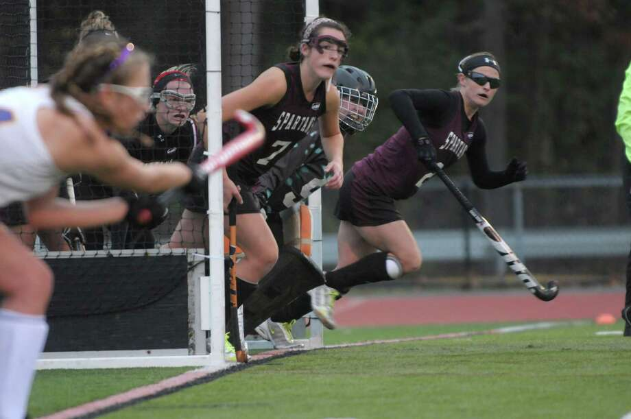 Burnt Hills Ballston Lake defenders sprint out of the goal during a corner by Johnstown during the Class B girl's field hockey finals on Sunday, Nov. 4, 2012 in Clifton Park, NY.  Burnt Hills Ballston Lake won by the score of three to one.   (Paul Buckowski / Times Union) Photo: Paul Buckowski