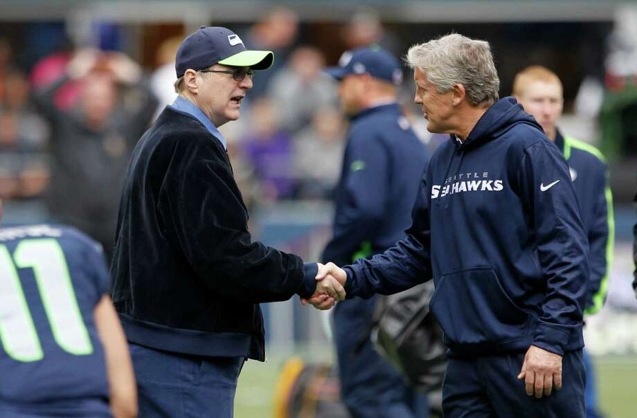 Seattle Seahawks team owner Paul Allen, center, talks with coach Pete Carroll before an NFL football game against the Minnesota Vikings, Sunday, Nov. 4, 2012, in Seattle. Photo: AP
