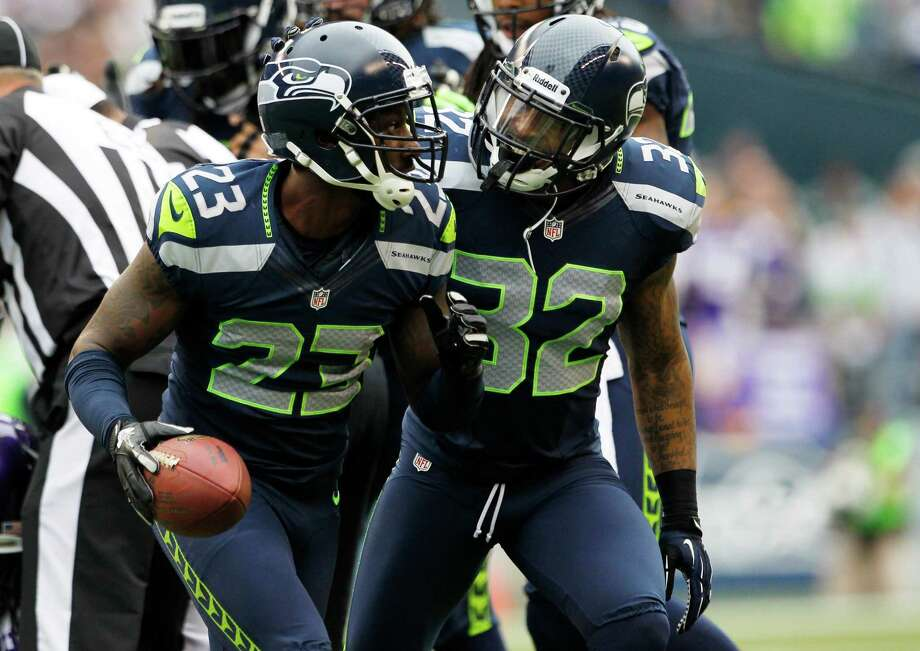 Seattle Seahawks' Marcus Trufant, left, and Jeron Johnson, right, celebrate a play in the first half of an NFL football game against the Minnesota Vikings, Sunday, Nov. 4, 2012, in Seattle. Photo: AP
