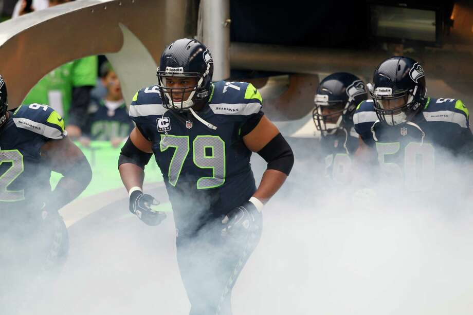 Seattle Seahawks' Red Bryant (79) runs onto the field prior to an NFL football game against the Minnesota Vikings, Sunday, Nov. 4, 2012, in Seattle. Photo: AP