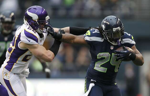 Marshawn Lynch ran for 124 yards and a touchdown, but it was rookie quarterback Russell Wilson who lifted Seattle. Photo: John Froschauer, Associated Press
