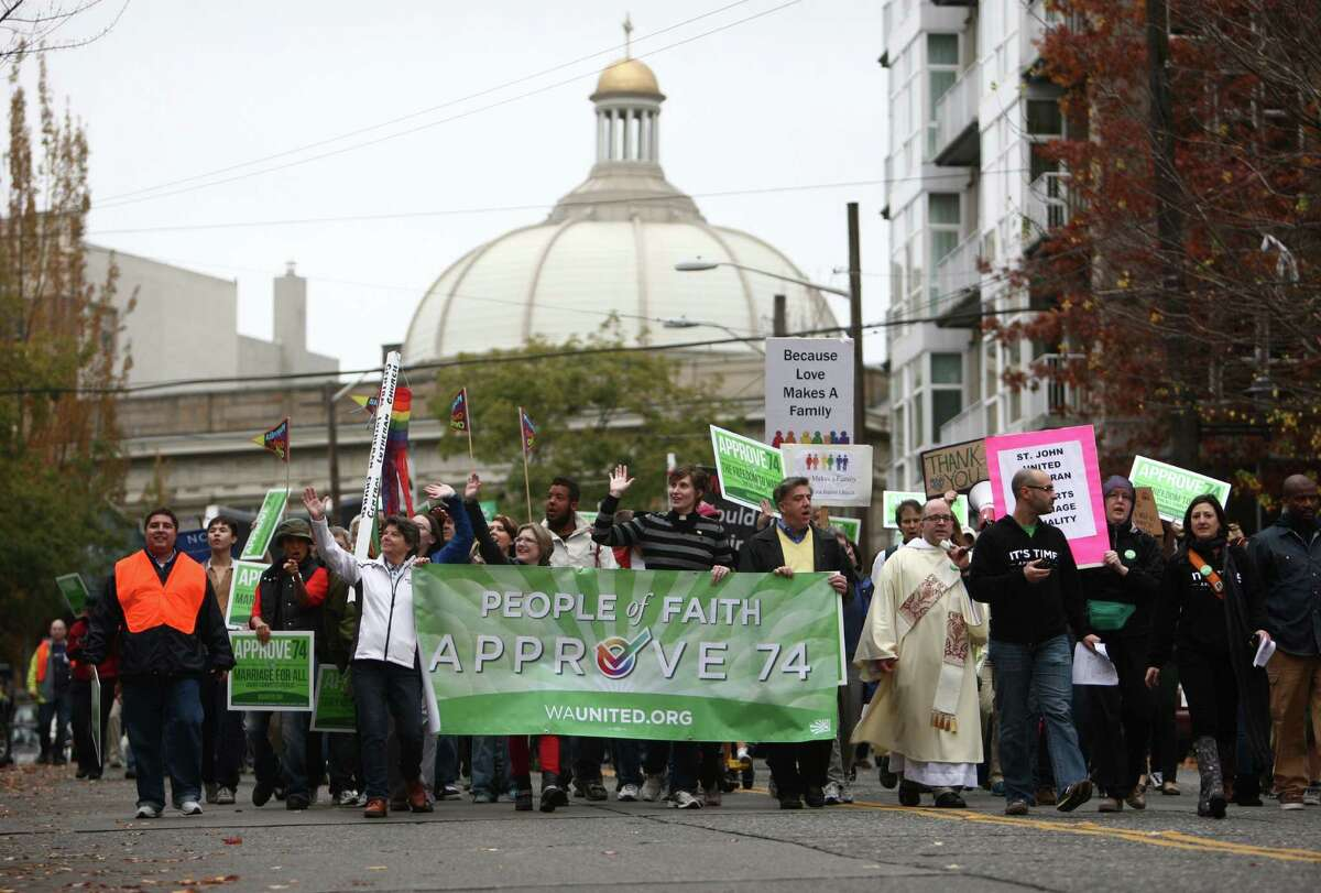 People in the faith community participate in a pro-Referendum 74 march and rally on Sunday, November 4, 2012 in Seattle. Hundreds of marriage equality supporters marched from Seattle's Central Lutheran Church to the King County Administration Building where they dropped their ballots in a drop box.