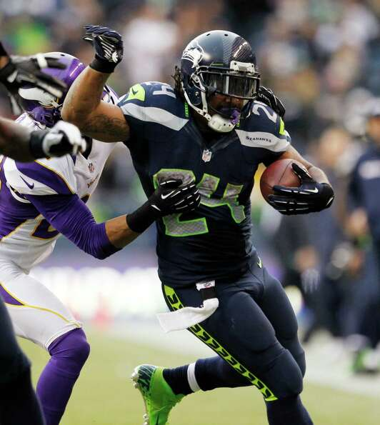 Seattle Seahawks' Marshawn Lynch rushes against the Minnesota Vikings in the second half of an NFL f