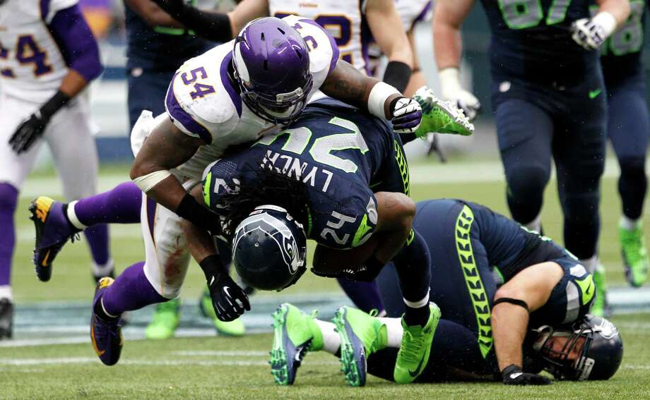 Seattle Seahawks' Marshawn Lynch (24) rushes under Minnesota Vikings' Jasper Brinkley (54) in the second half of an NFL football game, Sunday, Nov. 4, 2012, in Seattle. The Seahawks won 30-20. Photo: AP