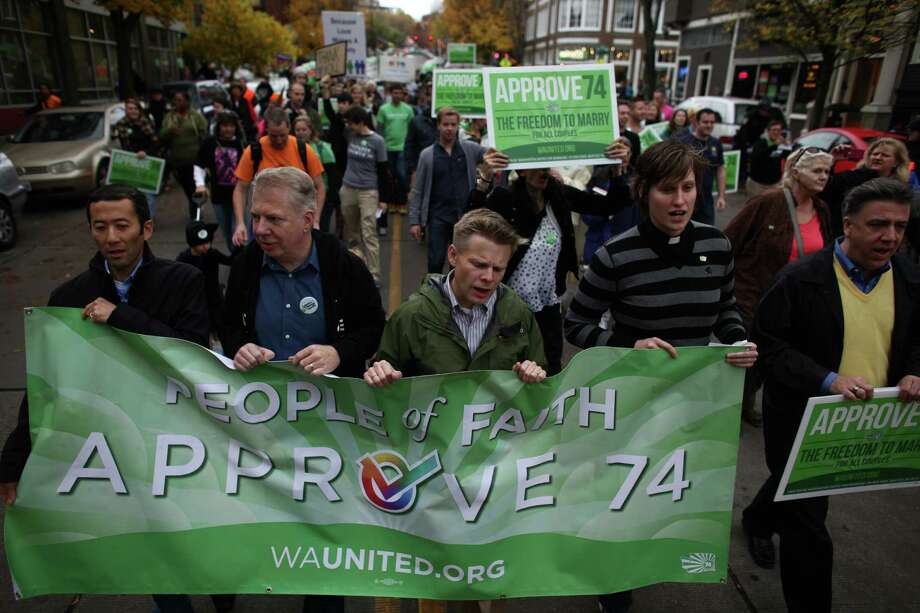 Marchers, including from left, Michael Shiosaka, his partner, State Senator Ed Murray, State Representative Jamie Pedersen and others in the faith community participate in a pro-Referendum 74 march and rally on Sunday, November 4, 2012 in Seattle. Hundreds of marriage equality supporters marched from Seattle's Central Lutheran Church to the King County Administration Building where they dropped their ballots in a drop box. Photo: JOSHUA TRUJILLO / SEATTLEPI.COM