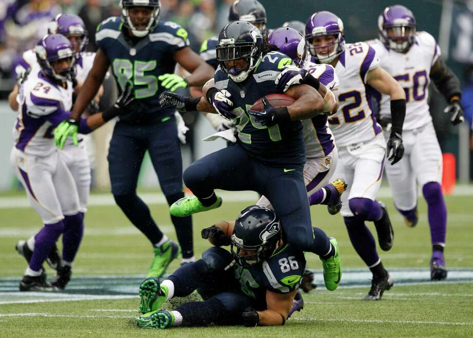 Seattle Seahawks' Marshawn Lynch (24) leaps over teammate Zach Miller (86) as he rushes against the Minnesota Vikings in the second half of an NFL football game, Sunday, Nov. 4, 2012, in Seattle. The Seahawks won 30-20. Photo: AP
