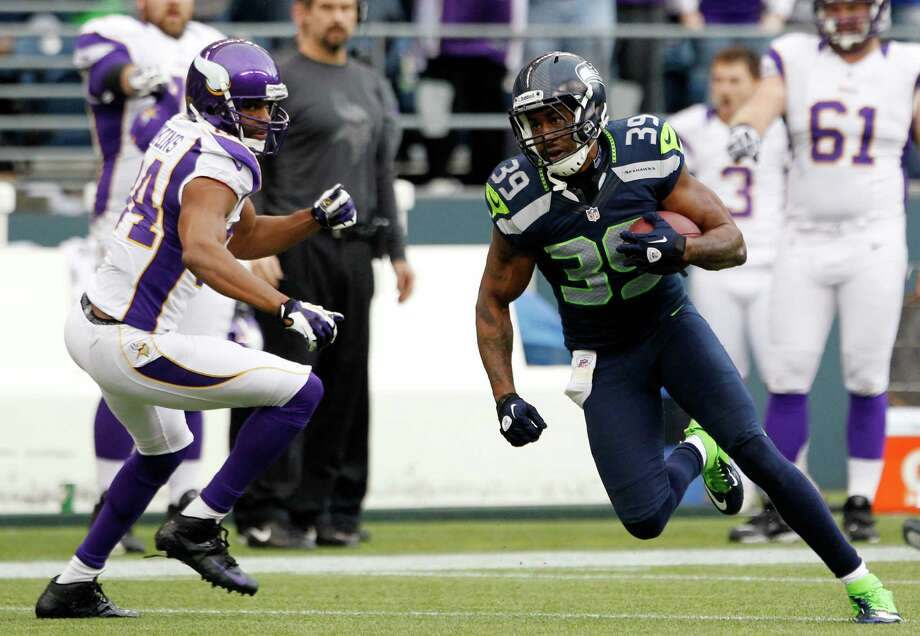 Seattle Seahawks' Brandon Browner (39) takes off past Minnesota Vikings' Michael Jenkins after an interception late in the second half of an NFL football game, Sunday, Nov. 4, 2012, in Seattle. The Seahawks won 30-20. Photo: AP