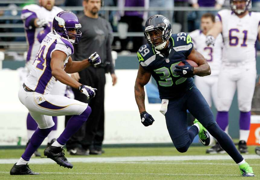 Seattle Seahawks' Brandon Browner (39) takes off past Minnesota Vikings' Michael Jenkins after an in