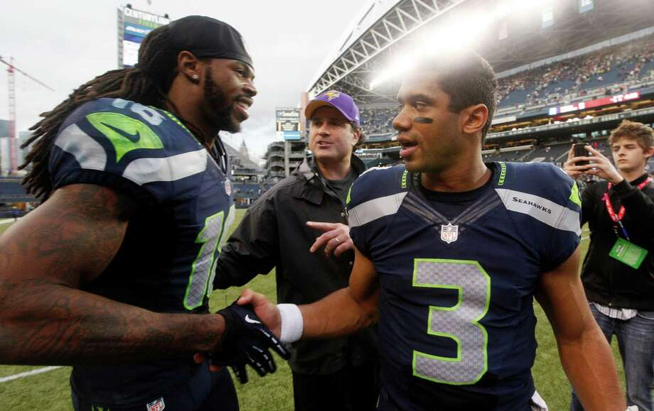Seattle Seahawks Sidney Rice, left, and Russell Wilson congratulate each other after the Seahawks defeated the Minnesota Vikings 30-20 in an NFL football game, Sunday, Nov. 4, 2012, in Seattle. Photo: AP