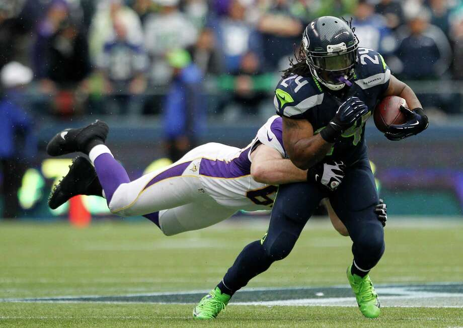 Seattle Seahawks' Marshawn Lynch (24) carries Minnesota Vikings' Jared Allen with him as he rushes in the second half of an NFL football game, Sunday, Nov. 4, 2012, in Seattle. The Seahawks won 30-20. Photo: AP