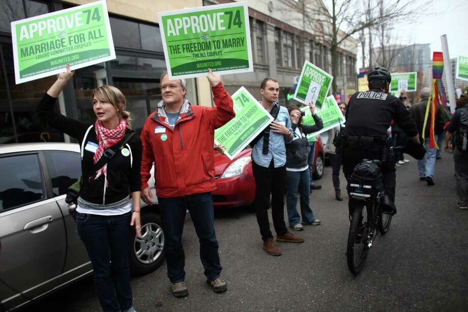 Members of Washington United For Marriage cheer as people in the faith community participate in a pro-Referendum 74 march and rally on Sunday, November 4, 2012 in Seattle. Hundreds of marriage equality supporters marched from Seattle's Central Lutheran Church to the King County Administration Building where they dropped their ballots in a drop box. Photo: JOSHUA TRUJILLO / SEATTLEPI.COM