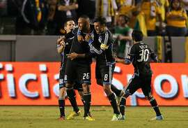 CARSON, CA - NOVEMBER 04:  Sam Cronin #4, Victor Bernardez #26, Chris Wondolowski #8 and Rafael Baca #30 of the San Jose Earthquakes react after the goal by Bernardez from a direct free kick in the 90th minute of the first leg of the MLS Western Conference Semifinal match at The Home Depot Center on November 4, 2012 in Carson, California. The Earthquakes defeated the Galaxy 1-0.  (Photo by Victor Decolongon/Getty Images)