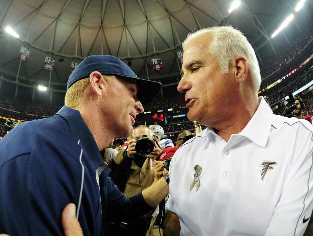 Head coach Mike Smith of the Atlanta Falcons (right) is congratulated by head coach Jason Garrett of the Dallas Cowboys after the game at the Georgia Dome on Nov. 4, 2012 in Atlanta, Georgia. The Falcons defeated the Cowboys 19-13. Photo: Scott Cunningham, Getty Images / 2012 Getty Images