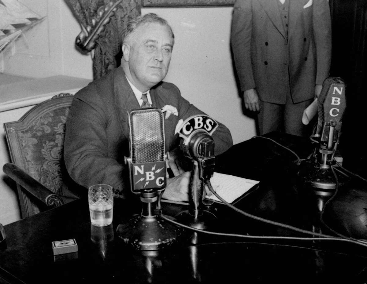 ADV. FOR SUN., NOV. 7--FILE--President Franklin D. Roosevelt delivers an address in the White House in Washington April 28, 1935. For his 'fireside chats,' Roosevelt was actually seated in front of three microphones in a White House room with no fireplace. (AP Photo)