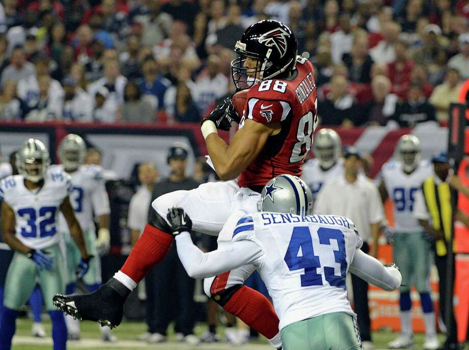 Atlanta Falcons tight end Tony Gonzalez (88) makes a catch as Dallas Cowboys safety Gerald Sensabaugh (43) defends during the first half of an NFL football game, Sunday, Nov. 4, 2012, in Atlanta. (AP Photo/Rich Addicks) Photo: Rich Addicks, Associated Press / FR170246 AP