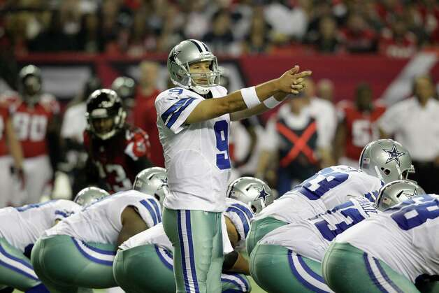 Dallas Cowboys quarterback Tony Romo (9) directs his teammates during the second half of an NFL football game against the Atlanta Falcons Sunday, Nov. 4, 2012, in Atlanta. (AP Photo/Chuck Burton) Photo: Chuck Burton, Associated Press / AP