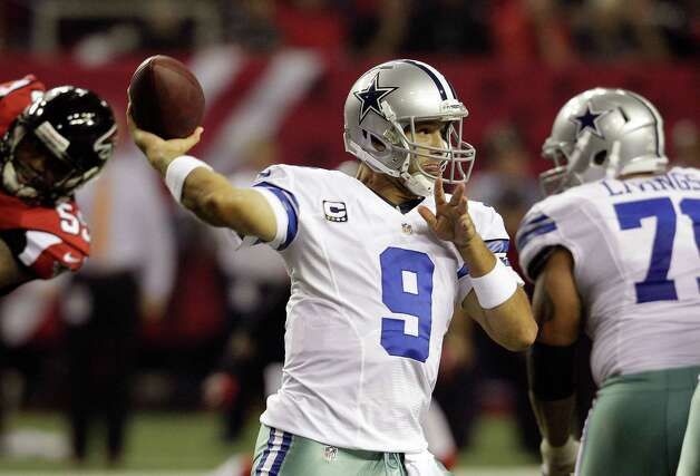 Dallas Cowboys quarterback Tony Romo (9) throws a pass during the second half of an NFL football game against the Atlanta Falcons Sunday, Nov. 4, 2012, in Atlanta. (AP Photo/Chuck Burton) Photo: Chuck Burton, Associated Press / AP