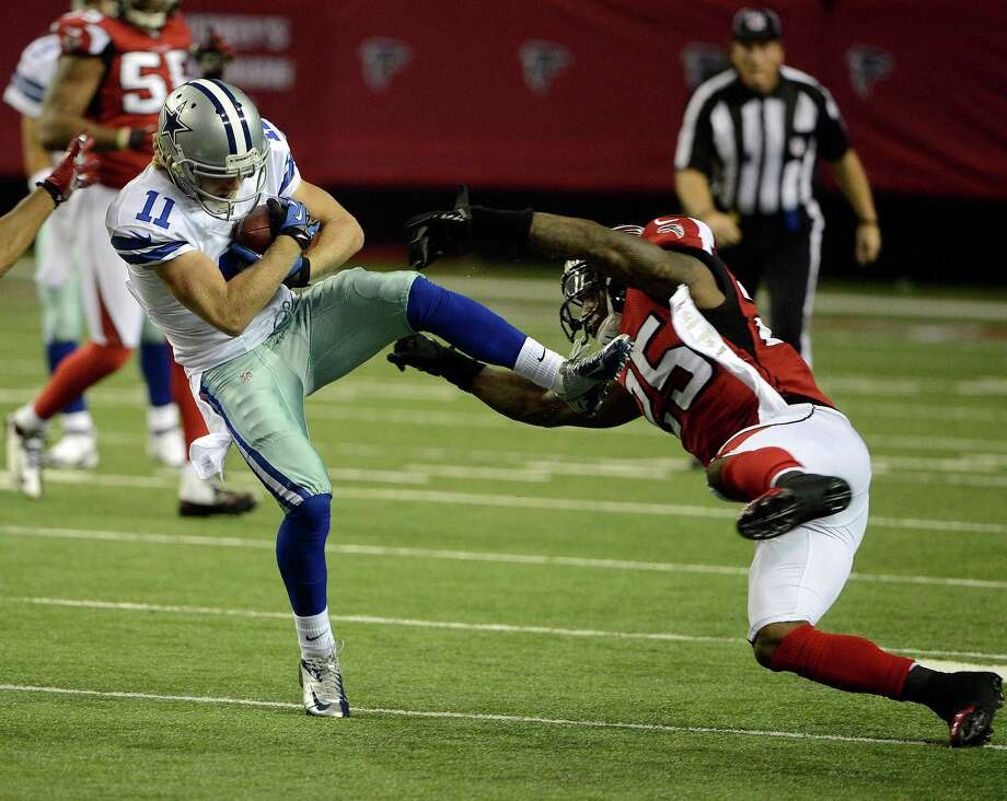 Dallas Cowboys wide receiver Cole Beasley (11) makes a catch as Atlanta Falcons safety William Moore (25) defends during the first half of an NFL football game, Sunday, Nov. 4, 2012, in Atlanta. (AP Photo/Rich Addicks) Photo: Rich Addicks, Associated Press / FR170246 AP