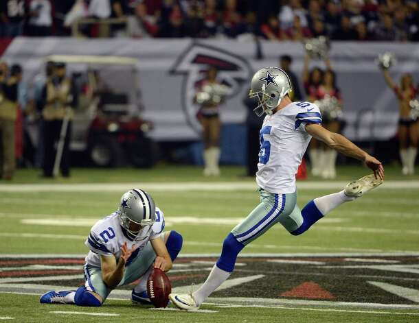 Dallas Cowboys kicker Dan Bailey (5) kicks a field goal aspunter Brian Moorman (2) holds during the first half of an NFL football game against the Atlanta Falcons  Sunday, Nov. 4, 2012, in Atlanta. (AP Photo/Rich Addicks) Photo: Rich Addicks, Associated Press / FR170246 AP