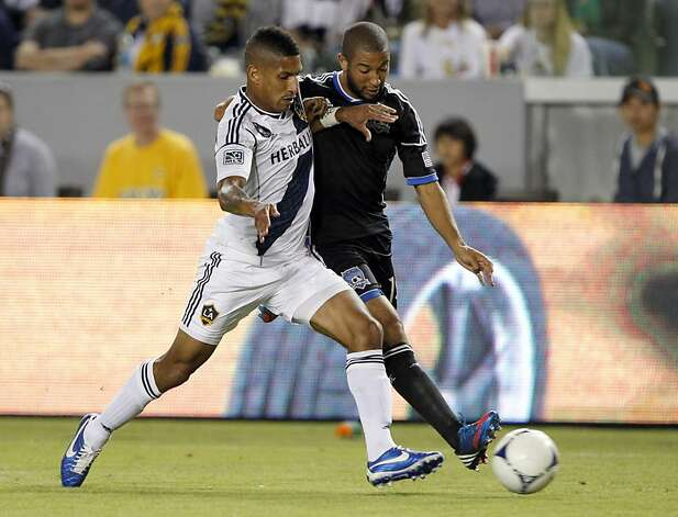 Los Angeles Galaxy defender Sean Franklin, left, battles San Jose Earthquakes midfielder Justin Morrow for the ball during the first half of their MLS playoff soccer match, Sunday, Nov. 4, 2012, in Carson, Calif. (AP Photo/Alex Gallardo) Photo: Alex Gallardo, Associated Press
