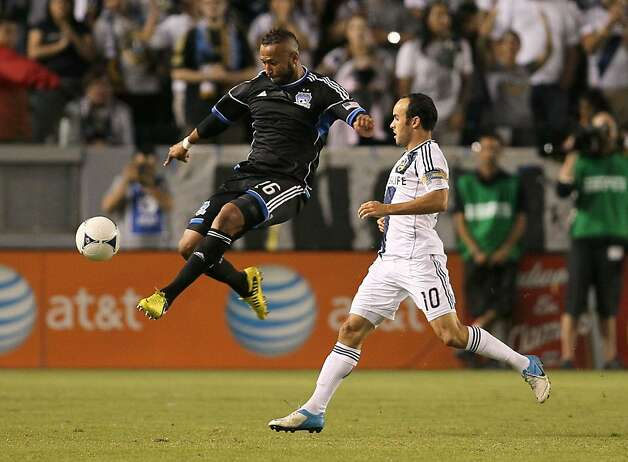 San Jose's Victor Bernardez leaps to volley the ball as the Galaxy's Landon Donovan pursues in Sunday's Quakes win. Photo: Victor Decolongon, Getty Images