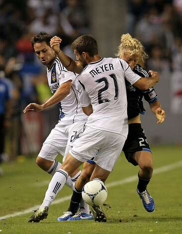 CARSON, CA - NOVEMBER 04:  Tommy Meyer #21 and Todd Dunivant #2 of the Los Angeles Galaxy defend Steven Lenhart #24 of the San Jose Earthquakes in the first half during the first leg of the MLS Western Conference Semifinal match at The Home Depot Center on November 4, 2012 in Carson, California.  (Photo by Victor Decolongon/Getty Images) Photo: Victor Decolongon, Getty Images
