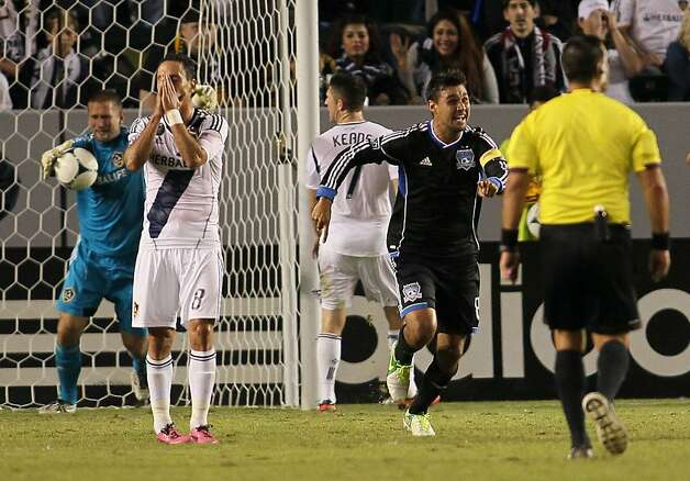 CARSON, CA - NOVEMBER 04:  Chris Wondolowski #8 of the San Jose Earthquakes and Marcelo Sarvas #8 of the Los Angeles Galaxy react to the goal from a direct free kick by Victor Bernardez #26 of the San Jose Earthquakes (not in photo) in the 90th minute of the first leg of the MLS Western Conference Semifinal match at The Home Depot Center on November 4, 2012 in Carson, California. The Earthquakes defeated the Galaxy 1-0. (Photo by Victor Decolongon/Getty Images) Photo: Victor Decolongon, Getty Images