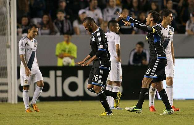CARSON, CA - NOVEMBER 04:  Victor Bernardez #26 and Chris Wondolowski #8 of the San Jose Earthquakes celebrate Bernardez's 90th minute goal as Juninho #19, Sean Franklin #5 and Omar Gonzalez #4 of the Los Angeles Galaxy look on dejected during the first leg of the MLS Western Conference Semifinal match at The Home Depot Center on November 4, 2012 in Carson, California. The Earthquakes defeated the Galaxy 1-0. (Photo by Victor Decolongon/Getty Images) Photo: Victor Decolongon, Getty Images