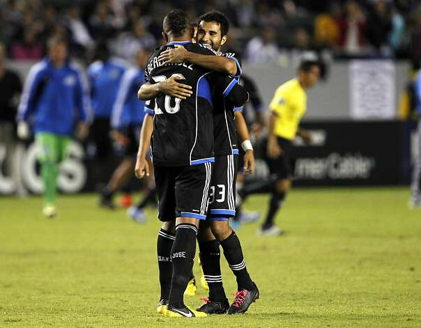 San Jose Earthquakes defender Steven Beitashour, right, hugs defender Victor Bernardez, of Honduras, for scoring the winning-goal to defeat the Los Angeles Galaxy during their MLS playoff soccer match, Sunday, Nov. 4, 2012, in Carson, Calif. San Jose won 1-0. (AP Photo/Alex Gallardo) Photo: Alex Gallardo, Associated Press
