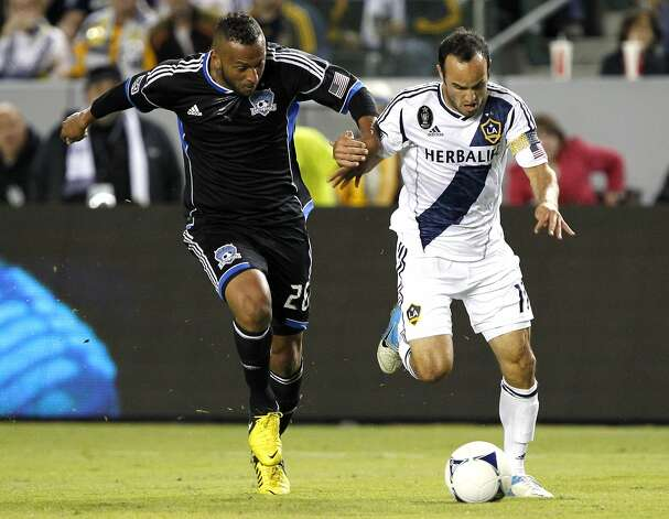 San Jose Earthquakes defender Victor Bernardez, left, of Honduras, defends against Los Angeles Galaxy midfielder Landon Donovan from attacking with the ball during the second half of their MLS playoff soccer match, Sunday, Nov. 4, 2012, in Carson, Calif. San Jose won 1-0. (AP Photo/Alex Gallardo) Photo: Alex Gallardo, Associated Press