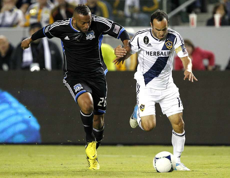 Quakes defender Victor Bernardez (left) tries to control Galaxy midfielder Landon Donovan in a California Clasico. Donovan and the Galaxy play the Quakes at Stanford on Saturday. Photo: Alex Gallardo, Associated Press