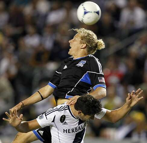 San Jose Earthquakes forward Steven Lenhart, top, goes up for the ball as Los Angeles Galaxy defender Omar Gonzalez defends during the first half of their MLS playoff soccer match, Sunday, Nov. 4, 2012, in Carson, Calif. (AP Photo/Alex Gallardo) Photo: Alex Gallardo, Associated Press
