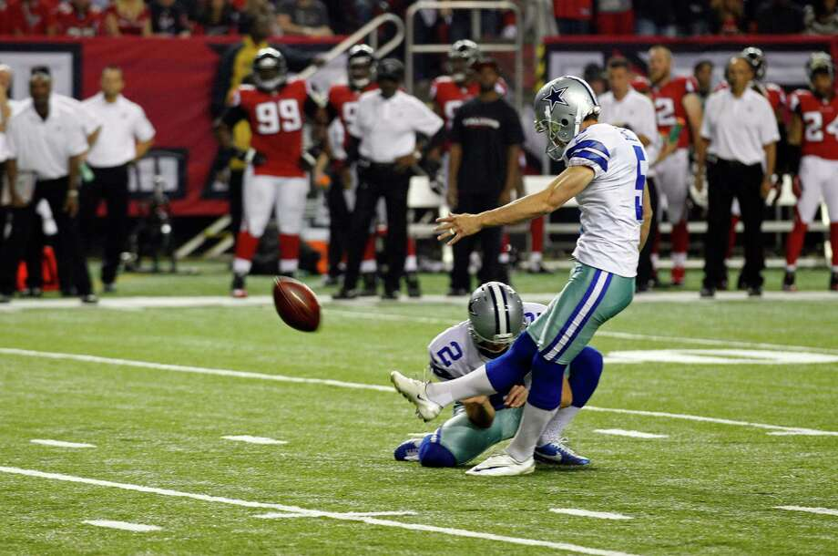 Dallas Cowboys' Dan Bailey (5) kicks a field goal as Brian Moorman (2) holds against the Atlanta Falcons during the second half of an NFL football game in Atlanta, Sunday, Nov. 4, 2012. Atlanta won 19-13. (AP Photo/Chuck Burton) Photo: Chuck Burton, Associated Press / AP