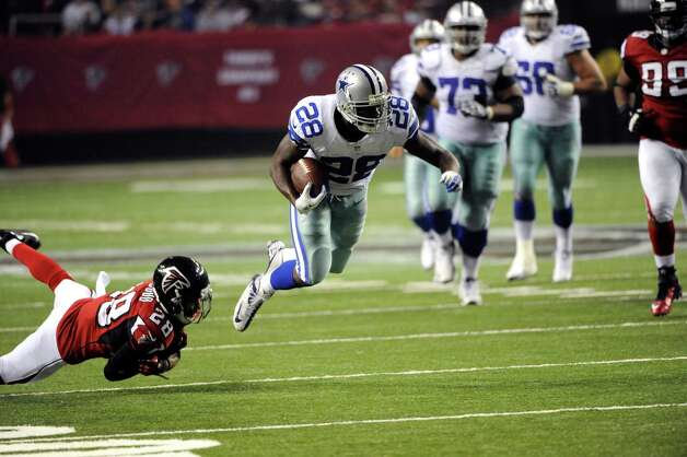 Dallas Cowboys running back Felix Jones (28) gets by Atlanta Falcons safety Thomas DeCoud (28) during the second half of an NFL football game, Sunday, Nov. 4, 2012, in Atlanta. (AP Photo/David Tulis) Photo: David Tulis, Associated Press / FR170493 AP