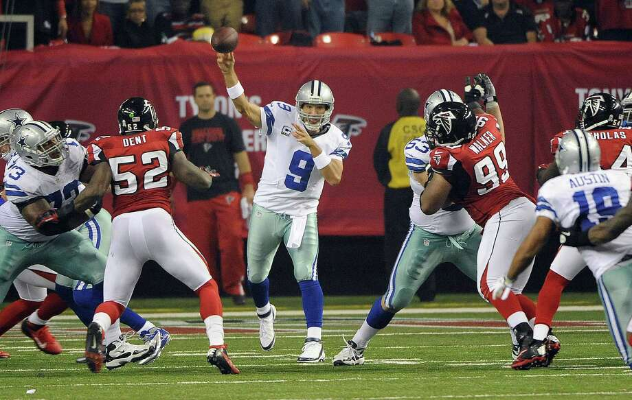Dallas Cowboys quarterback Tony Romo (9) throws from the pocket during the second half of an NFL football game against the Atlanta Falcons Sunday, Nov. 4, 2012, in Atlanta. (AP Photo/David Tulis) Photo: David Tulis, Associated Press / FR170493 AP